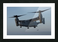An MV-22 Osprey prepares to land on the flight deck of USS Anchorage. Picture Frame print