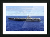 The aircraft carrier USS Abraham Lincoln transits across the Pacific Ocean. Picture Frame print