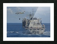 An MH-60S Sea Hawk conducts a vertical replenishment with USNS Bridge. Picture Frame print