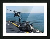 MH-53E Sea Dragon helicopters take off from the flight deck of USS Wasp. Picture Frame print