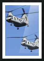 Two U.S. Marine Corps CH-46E Sea Knight helicopters in flight. Picture Frame print