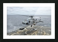 An MH-60R Sea Hawk helicopter lifts off from USS Wayne E. Meyer. Picture Frame print