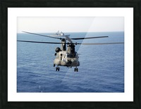 A U.S. Army MH-47 Chinook prepares to land. Picture Frame print