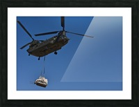 A U.S. Army CH-47 Chinook carries a bulldozer to a drop site. Picture Frame print