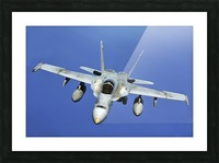 A F-A-18 Hornet participates in a mission in support of Rim of the Pacific. Picture Frame print