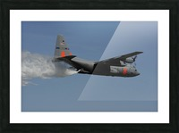 A U.S. Air Force C-130 Hercules releases its payload of water during training over South Carolina. Picture Frame print