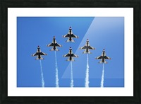 The U.S. Air Force Thunderbirds perform a 6-ship formation flyby during an air show. Picture Frame print