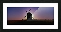 Windmill against the sunset north west France. Picture Frame print