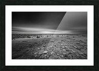Dramatic sunset at a small bay and rocky beach Picture Frame print