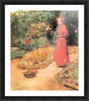 Woman cuts roses in a garden by Hassam Picture Frame print