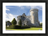 Stone castle with turret, manicured grass, gardens, fountain, blue sky and clouds; County Clare, Ireland Picture Frame print
