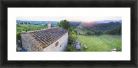 A stone house and a view of the lush landscape at sunset, Villa Capanuccia; Florence, Italy Picture Frame print