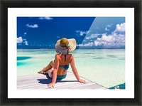 Sexy woman in bikini enjoy in tropical resort, sitting, back view Picture Frame print