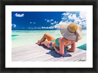 Woman in bikini lying on tropical beach at Maldives Picture Frame print