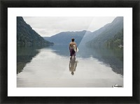 A Young Man Wearing A Swimsuit Stands In Cameron Lake; British Columbia Canada Picture Frame print