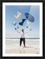 A Man Stands In The Ocean With Items From Work And Vacation Flying Over His Head; Tarifa, Cadiz, Andalusia, Spain Picture Frame print