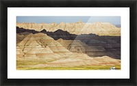 Light and shadows paint the landscape of badlands national park; south dakota united states of america Picture Frame print