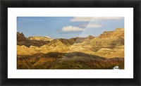 Dramatic light on the eroded formations of badlands national park; south dakota united states of america Picture Frame print