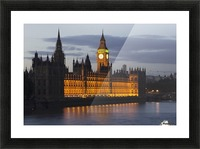 A Building And Clock Tower Along The Water's Edge Illuminated At Dusk; London, England Picture Frame print
