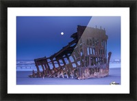 The moon sets over the wreck of the Peter Iredale; Oregon, United States of America Picture Frame print