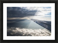 A commercial jet flies through the clouds; Colorado, United States of America Picture Frame print