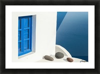 Whitewash building with blue trimmed window along the Aegean sea; Oia, Santorini, Greece Picture Frame print