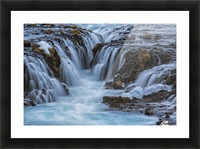 Turquoise water flowing over rocks into a river; Bruarfoss, Iceland Picture Frame print