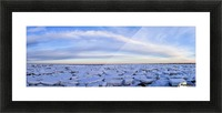 Ice forms on the shores of Hudson Bay as sunset starts to light up the clouds; Churchill, Manitoba, Canada Picture Frame print