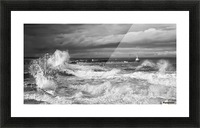 Waves crashing along the coast with a small lighthouse at the end of a pier; Amble, Northumberland, England Picture Frame print