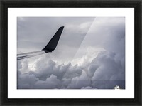 A commercial jet flies above the clouds over Illinois; United States of America Picture Frame print