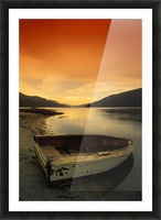 Old Rowboat At Water's Edge With Sunset Background Picture Frame print