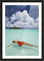 French Polynesia, Woman Floating In Ocean Water. Picture Frame print