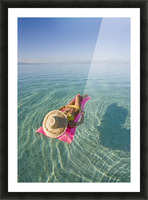 French Polynesia, Tahiti, Moorea, Woman Floating In Water. Picture Frame print