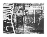 outdoor chairs in the city in black and white Picture Frame print