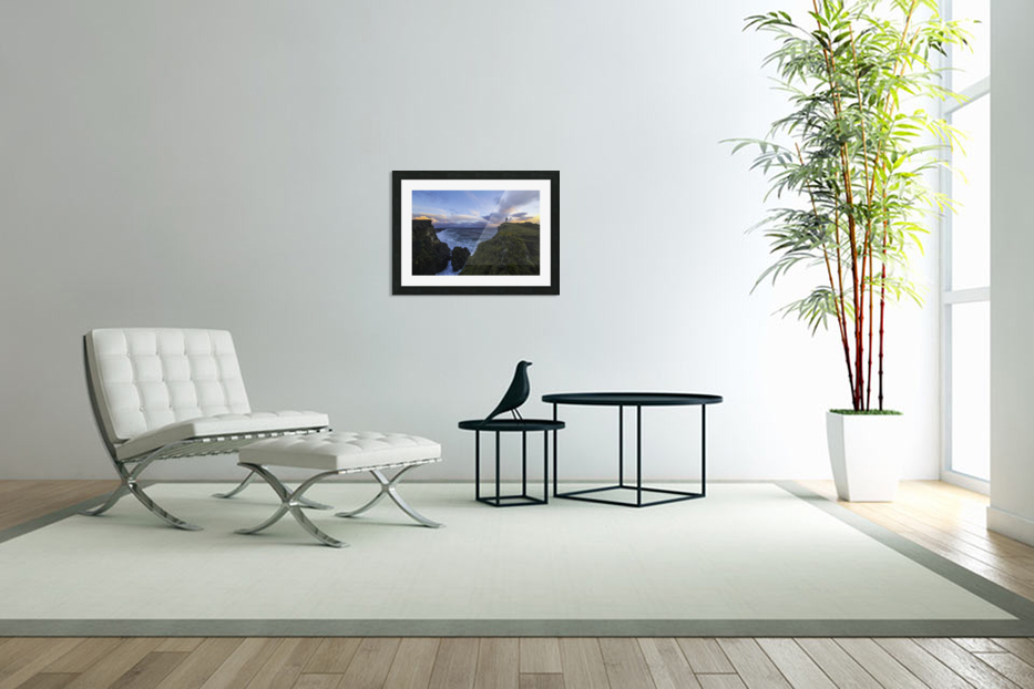 Person standing on a cliff face while the Atlantic Ocean pounds the shores beneath them; Iceland in Custom Picture Frame