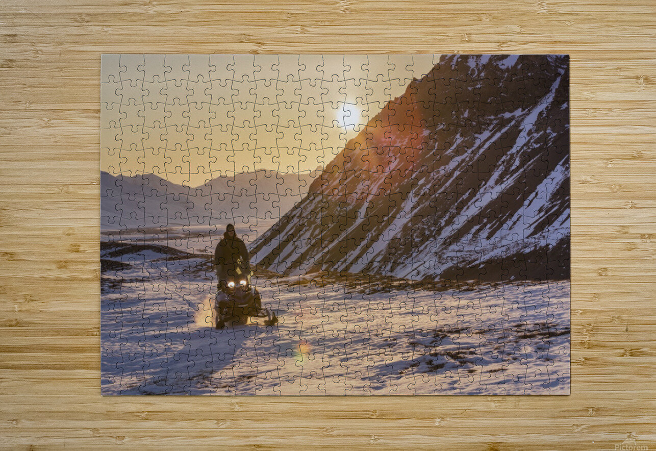 Man riding a snowmachine up the Anaktuvuk River Valley at sunset, Gates of the Arctic National Park, Brooks Range, Arctic Alaska  HD Metal print with Floating Frame on Back