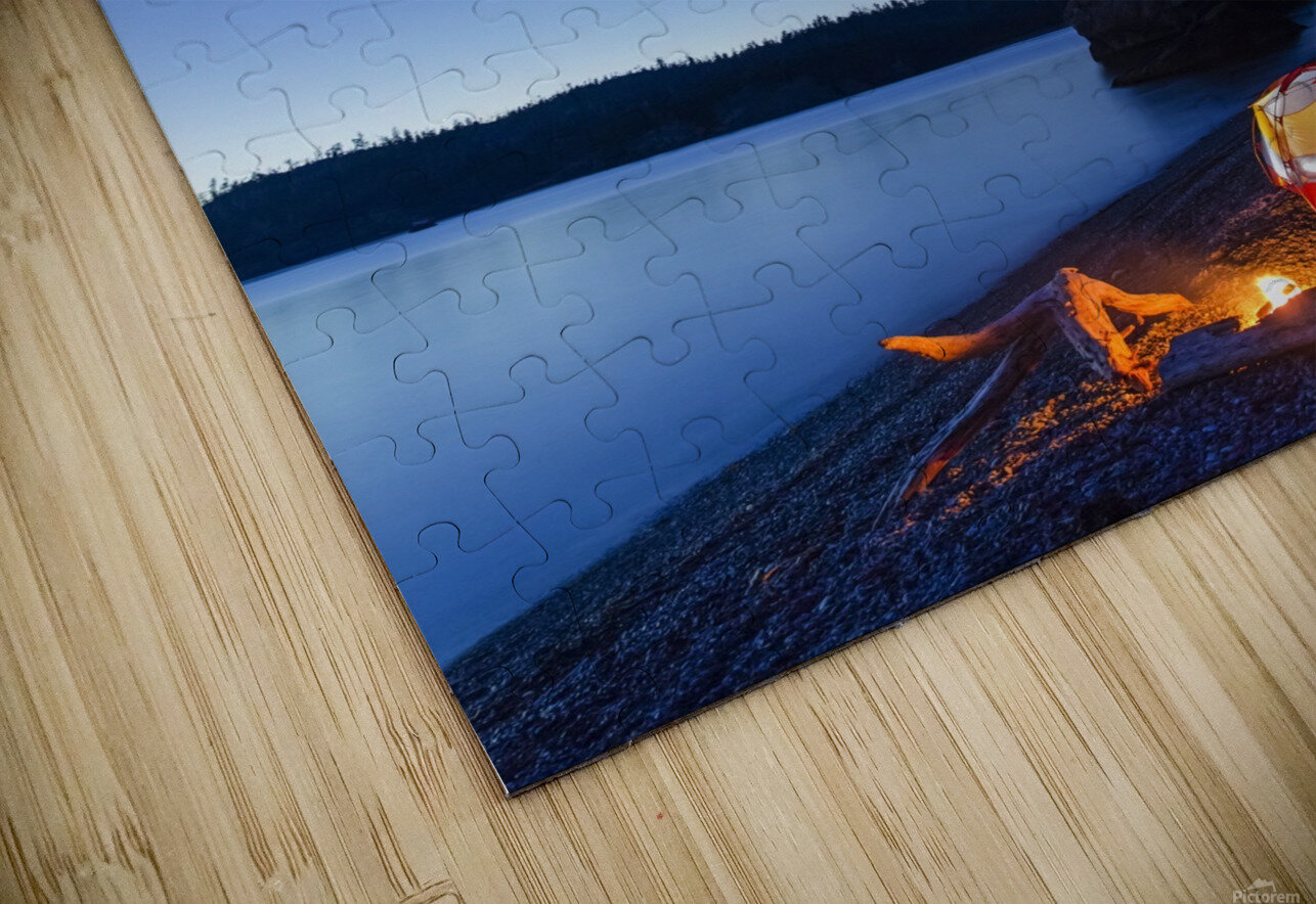 A campfire built on a beach at dusk next to a glowing tent, tranquil ocean water reflecting the warm light, Hesketh Island; Homer, Alaska, United States of America  HD Sublimation Metal print