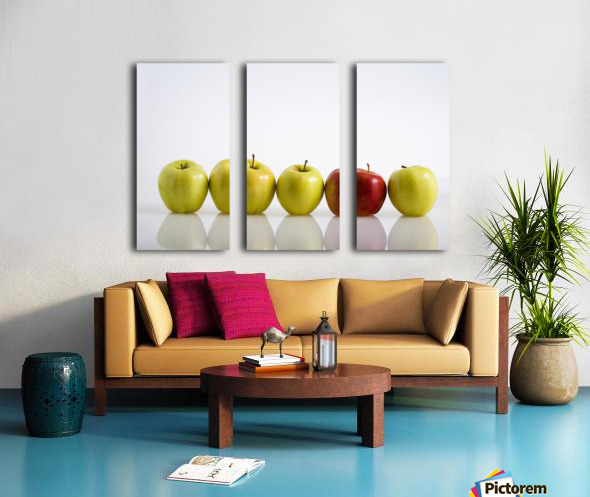 Four Yellow Apples With One Red Apple In A Row On A Reflective Surface; Calgary, Alberta, Canada Split Canvas print