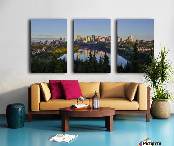 Skyline of downtown Edmonton reflected in the North Saskatchewan River under a blue sky; Edmonton, Alberta, Canada Split Canvas print