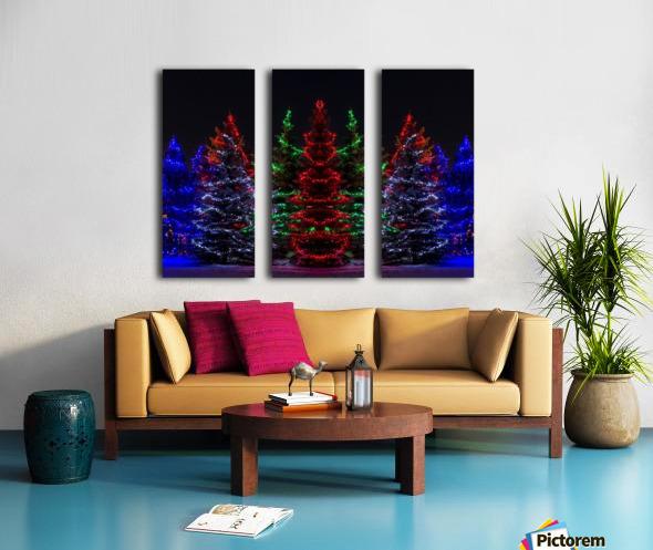 Colourful Christmas lights around several evergreen trees; Calgary, Alberta, Canada Split Canvas print
