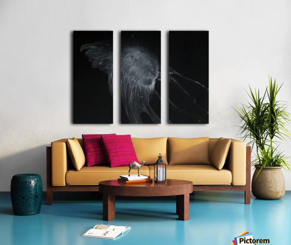 Glowing grey jellyfish in the dark water Split Canvas print