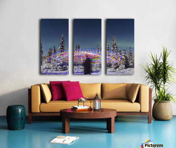 The Aurora Borealis dances over the top of a vibrant spiral light painting, the blurry figure of a man in the middle of the light painting, moonlight casting shadows on snow covered spruce trees on a clear winter night, interior Alaska; Gakona, Alaska, Un Split Canvas print