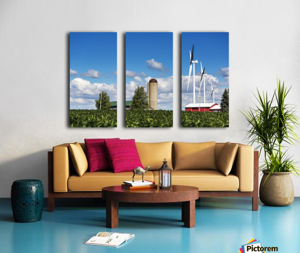 Large metal windmills in a farm yard with red barn and silo, soy bean field in the foreground and blue sky and clouds in the background; Ontario, Canada Split Canvas print
