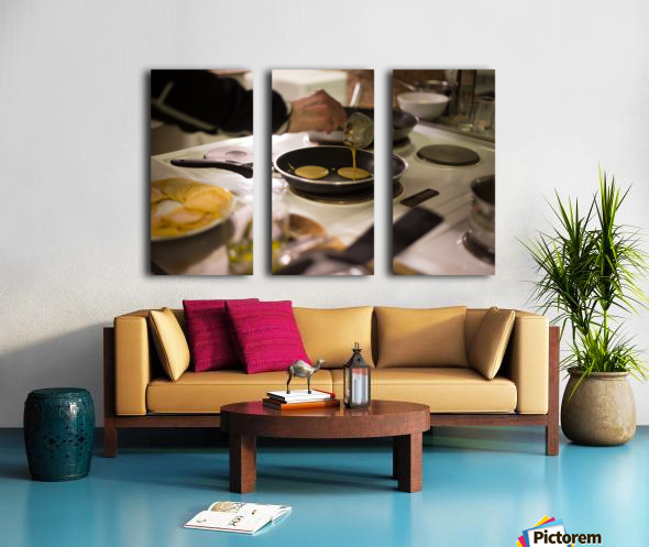 Cooking pancakes in kitchen Split Canvas print