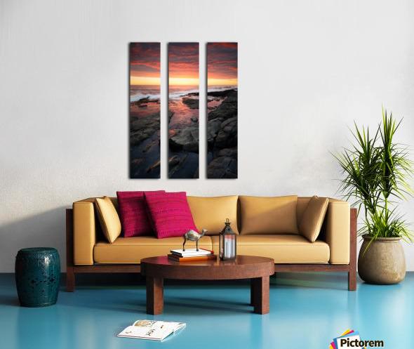 Sunset over rocky coastline Split Canvas print