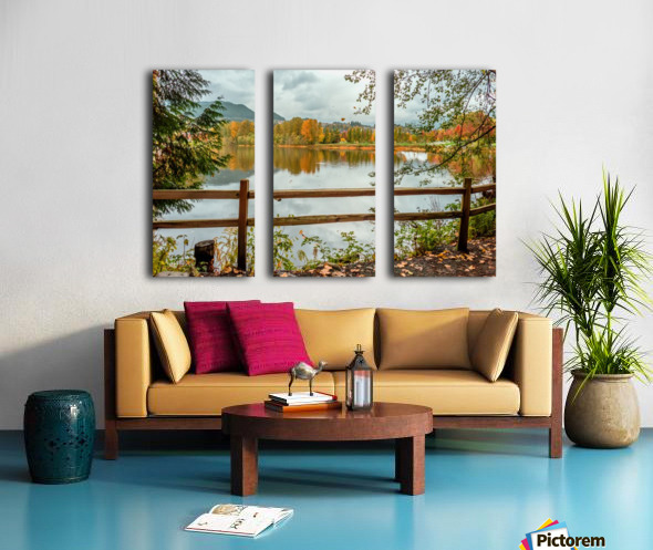 Wooden hedge blocks, falling autumn leaves, the water surface of the pond Split Canvas print