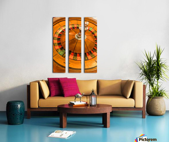 Round, wooden roulette wheel with numbers around the wheel Split Canvas print