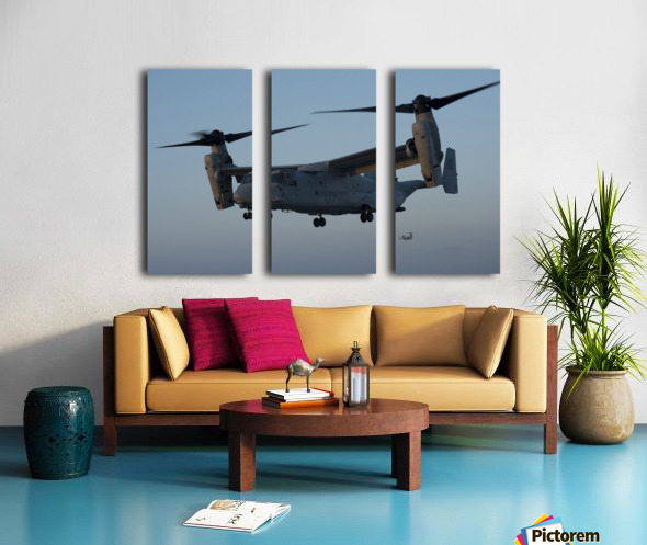 An MV-22 Osprey prepares to land on the flight deck of USS Anchorage. Split Canvas print
