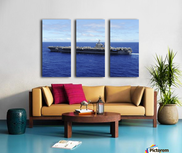The aircraft carrier USS Abraham Lincoln transits across the Pacific Ocean. Split Canvas print