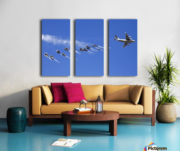 A C-17 Globemaster ejects a supply load of pallets during Operation Koranai Permakhtag. Split Canvas print